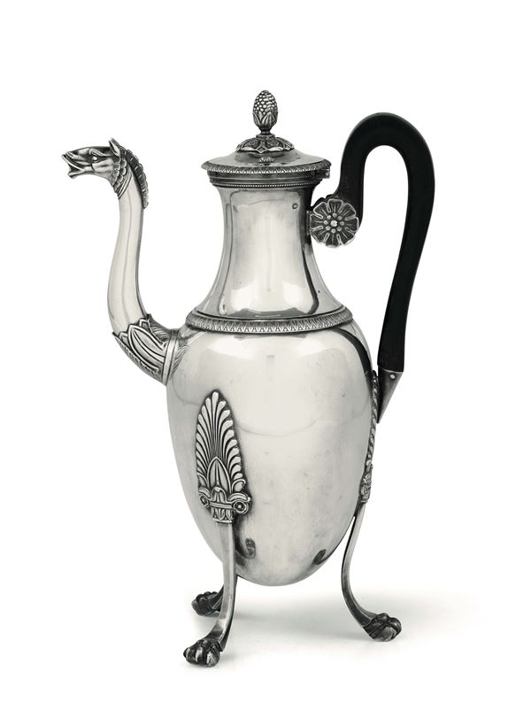 A coffee pot in first-title silver, embossed and chiselled and handle in ebanized wood, Paris first quarter of the 19th century. Title marks in use from 1809 to 1819 and mark for silversmith GR (unidentified).
