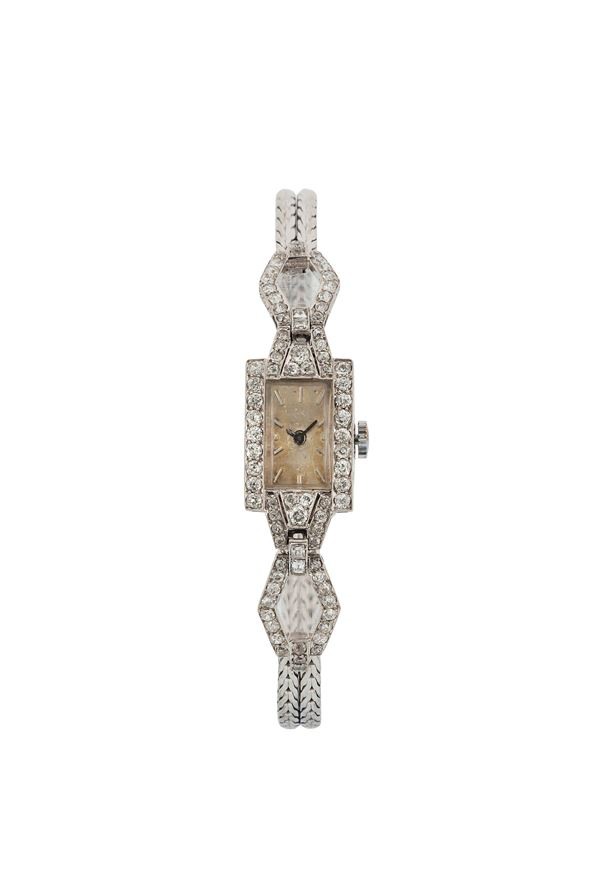UNIVERSAL GENEVE, 18K white gold lady's wristwatch with gold integrated bracelet. Made circa 1930