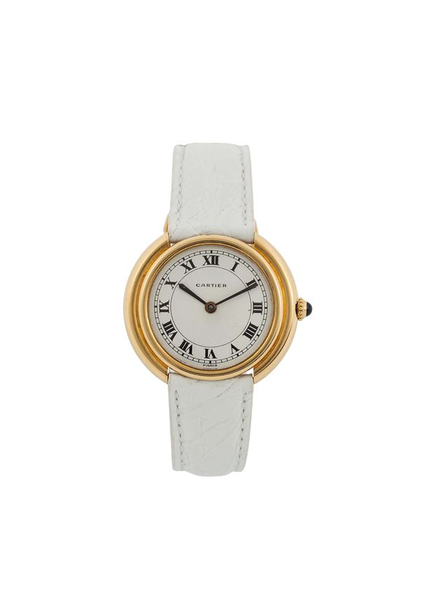 CARTIER, Paris, RONDE, YELLOW GOLD. Fine, self-winding, 18K yellow gold wristwatch with original buckle. Accompanied by the original  box. Made circa 1980