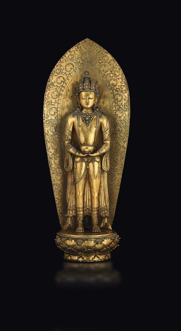 A large and rare gilt bronze figure of a standing Amitayus with aura on a lotus flower, Zanabazar, Mongolia,  [..]