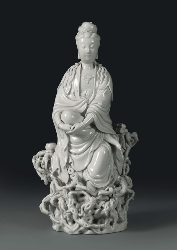 A Guanyin on roots in Blanc de Chine porcelain, China, 20th century