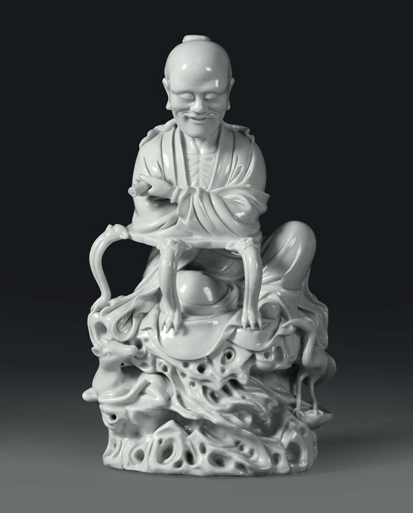 A sitting wiseman in Blanc de Chine porcelain, China, 20th century