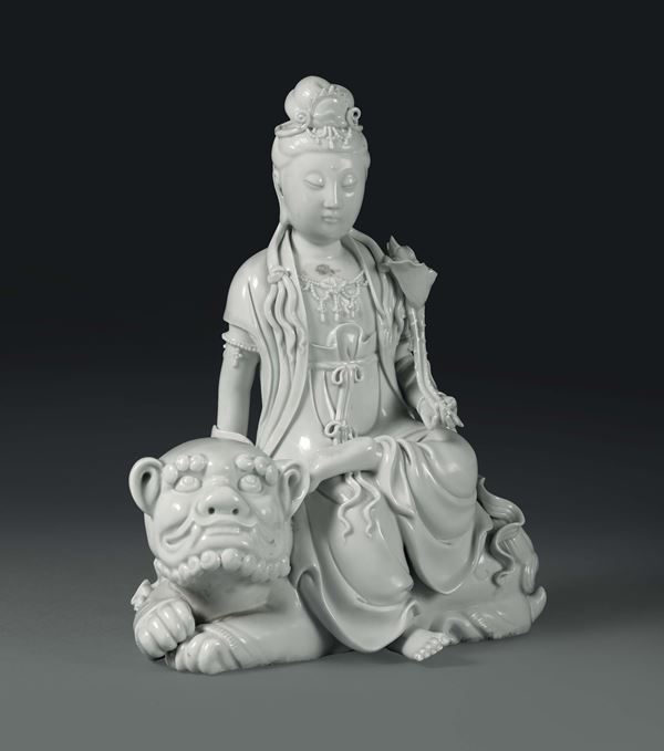 A Guanyin sitting on a Pho dog in Blanc de Chine porcelain, China, Qing dynasty, 19th century