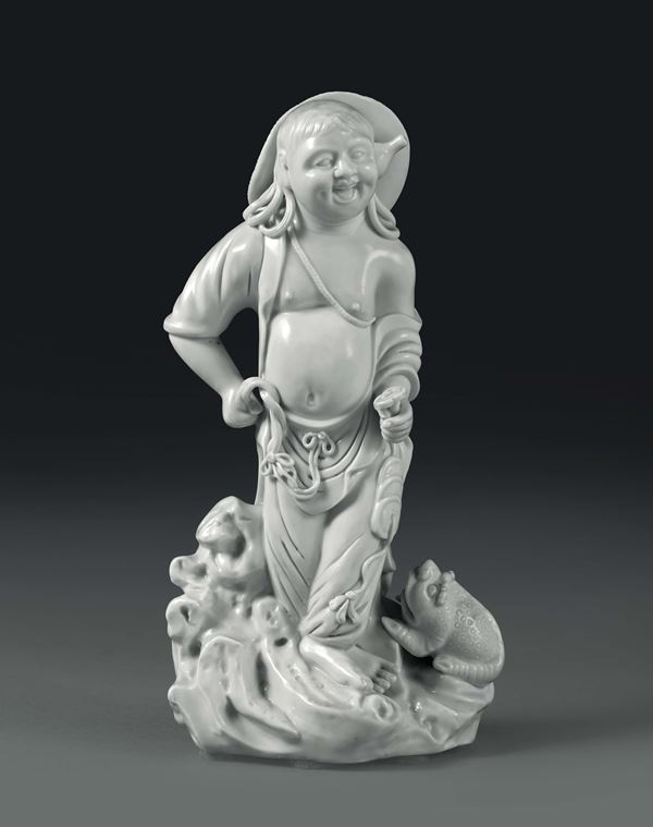 A peasant with a toad in Blanc de Chine porcelain, China, 20th century