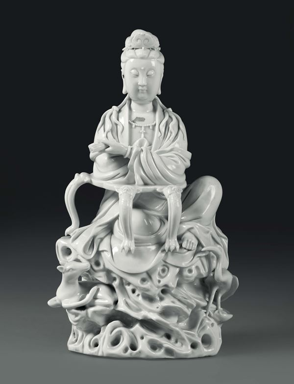 A sitting Guanyin in Blanc de Chine porcelain, China, Qing dynasty, 20th century