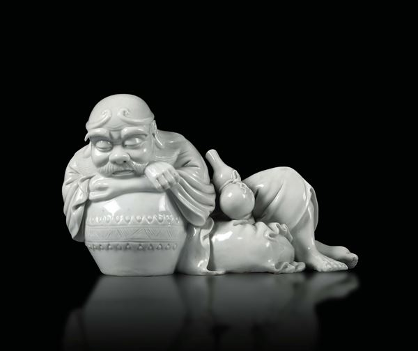 A crouching male figure in Blanc de Chine porcelain, China 20th century