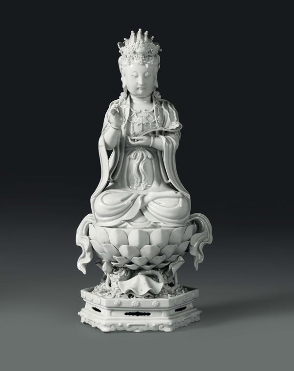 A Guanyin sitting on a lotus flower in Blanc de Chine porcelain, China, Qing dynasty, 19th century