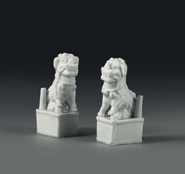 Two small dogs in Blanc de Chine porcelain, China, 20th century