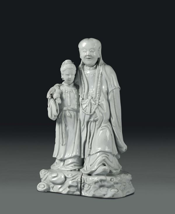 A wiseman with girl in Blanc de Chine porcelain, China, Qing dynasty, 19th century
