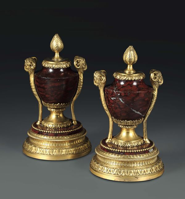 A pair of vases in red marble with rich gilt bronze stands, France 19th century