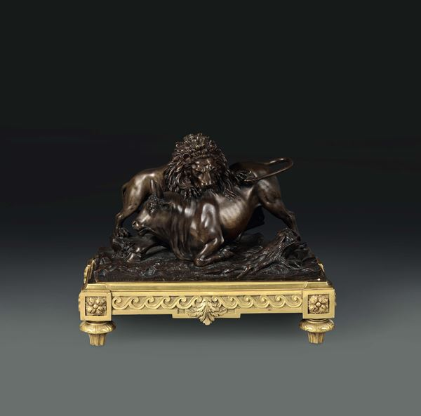 A bull attacked by a lion. Molten, chiselled and gilt bronze, French art of the 19th century