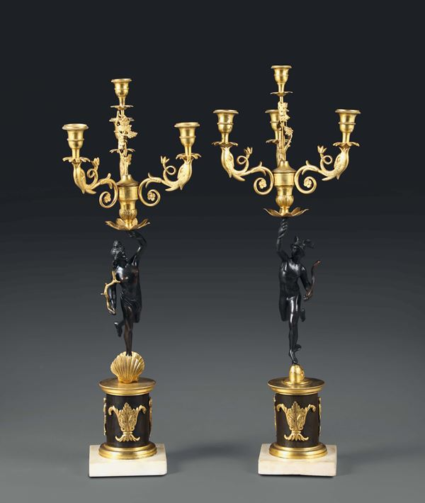 A pair of bronze candle holders with four arms, 19th century