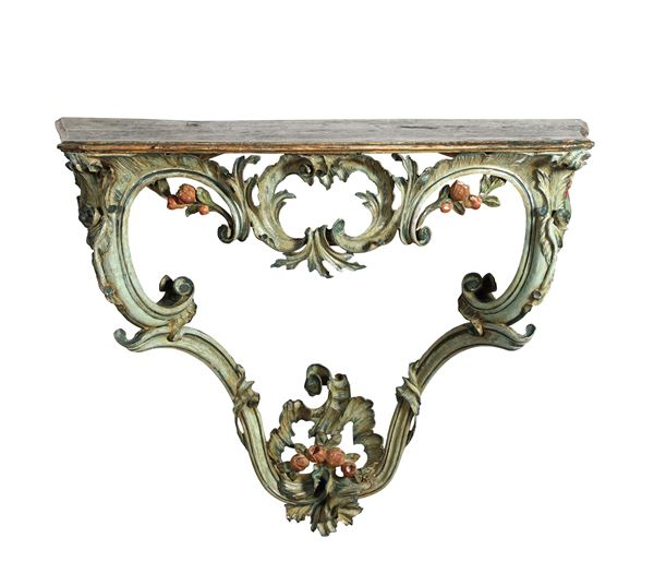 A Louis XV console table in carved and lacquered wood, 18th century