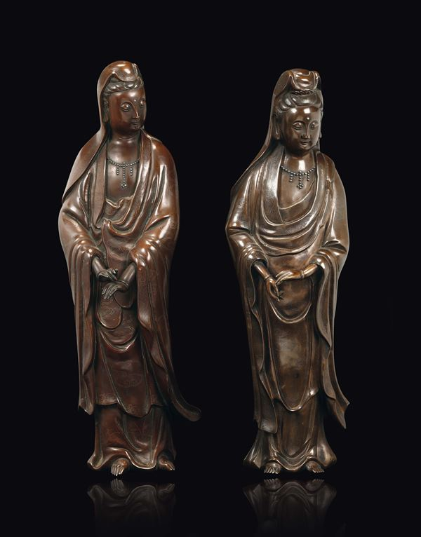Two bronze figures of standing Guanyin with silver inlays with clouds decoration, China, Qing Dynasty, 18th/19th century