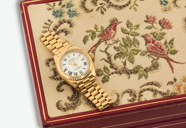 """ROLEX, Oyster Perpetual, Datejust, Superlative Chronometer Officially Certified"""", Ref. 6916. Made in 1979. Very fine, center seconds, self-winding, water-resistant, yellow gold wristwatch with date and an 18K yellow gold Rolex bracelet with concealed deployant clasp. Accompanied by the original box and additional links"""