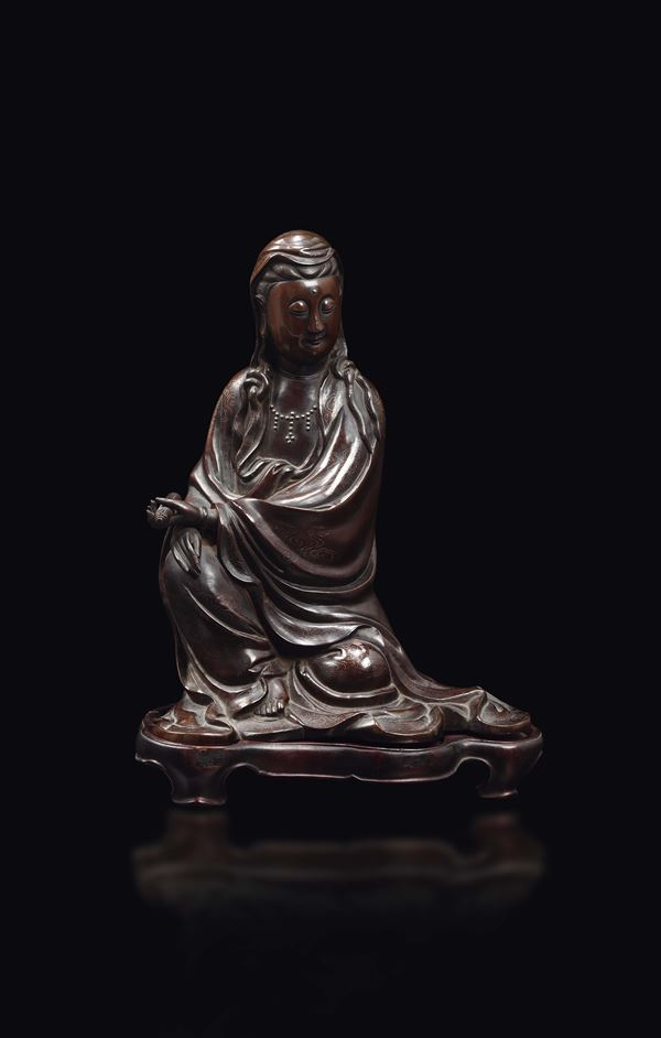 A bronze figure of seated Guanyin with silver inlays with clouds decoration, China, Qing Dynasty, 18th century