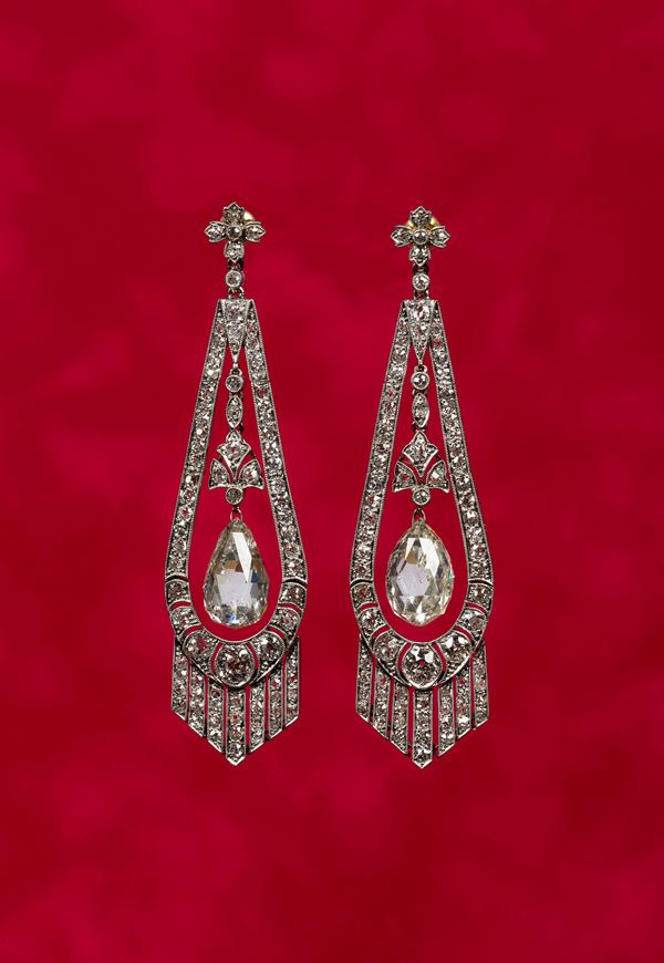 Diamond and platinum pendant earrings with a central Briolette cut diamond drop.French hallmarks. Acquired  [..]