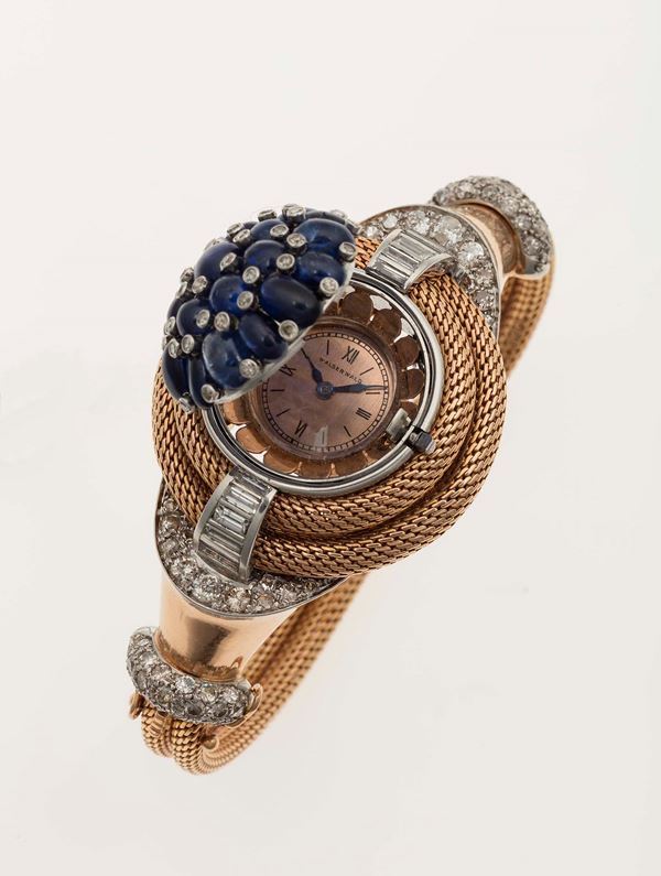 Bracelet watch in platinum and 750 yellow gold with cabochon sapphires and diamonds.