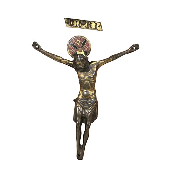 A Corpus Christi in molten, chiselled and gilded bronze. Italian Gothic goldsmithry from the early 15th century