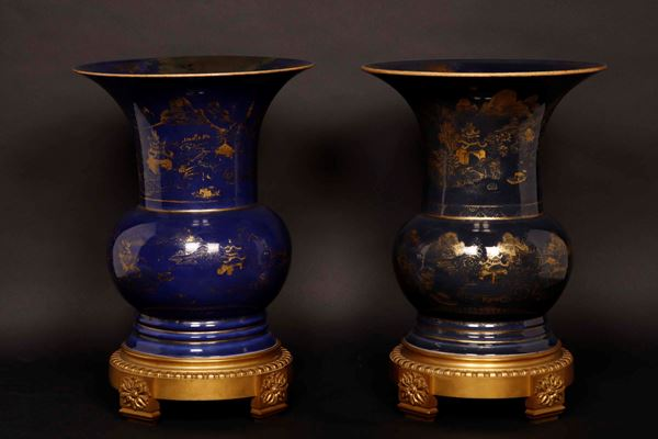 Two blue-ground porcelain vases with gilt decoration on a bronze mounting, China, Qing Dynasty, 19th  [..]