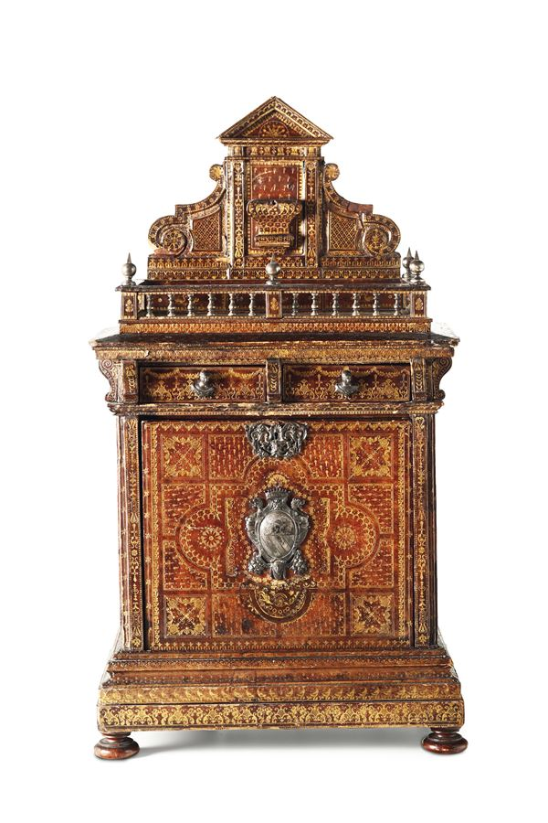 A table coin cabinet in an architectural style, coated in etched leather with gold decors. Germany or Netherlands, 17th-18th century