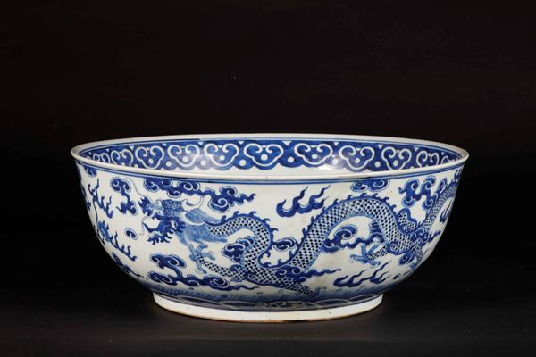 A large blue and white bowl with a decor of dragons among the clouds, China, Qing Dynasty, 19th century