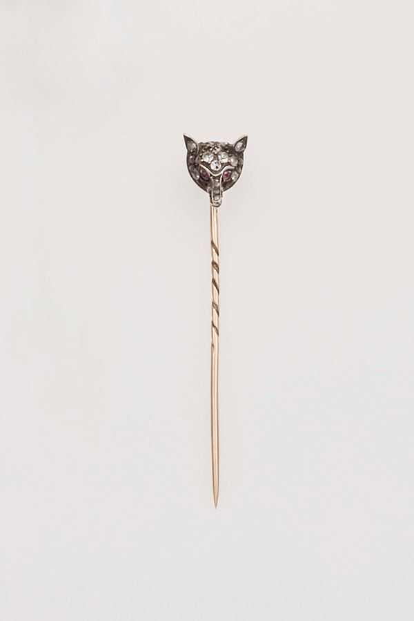 Diamond, ruby, gold and silver jabot pin. Cartier Paris. Fitted case