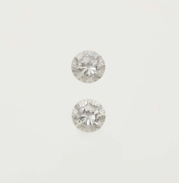 Two unmounted brilliant-cut diamonds weighings 0.90 and 0.91 carats