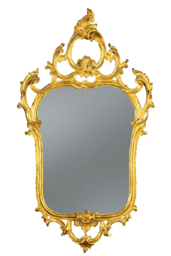 A series of four Louis XV mirrors in carved and gilded wood, Lombardy, half of the 18th century