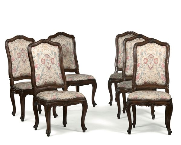 Six chairs in sculpted walnut, Genoa 18th century