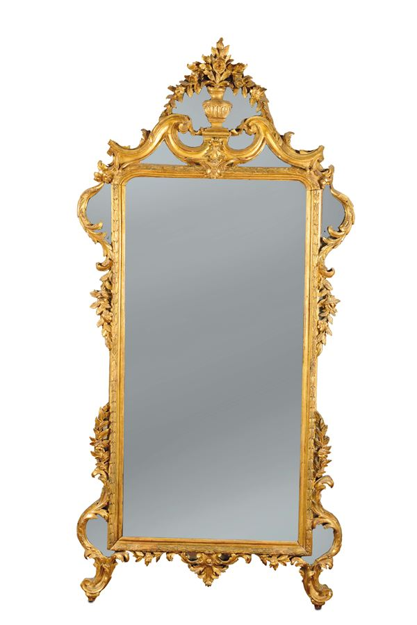 A mirror in carved and gilded wood, Genoa, eighth decade of the 18th century