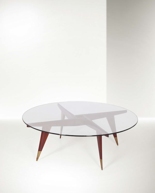 Gio Ponti, a coffee table with a wooden structure and brass details. Crystal top. Original certificate  [..]