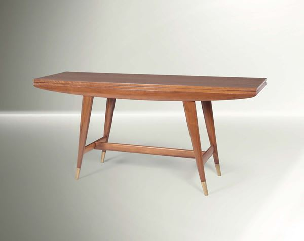 Gio Ponti, a table with a console-foldable top. Wooden structure, brass tips and metal details. Original  [..]