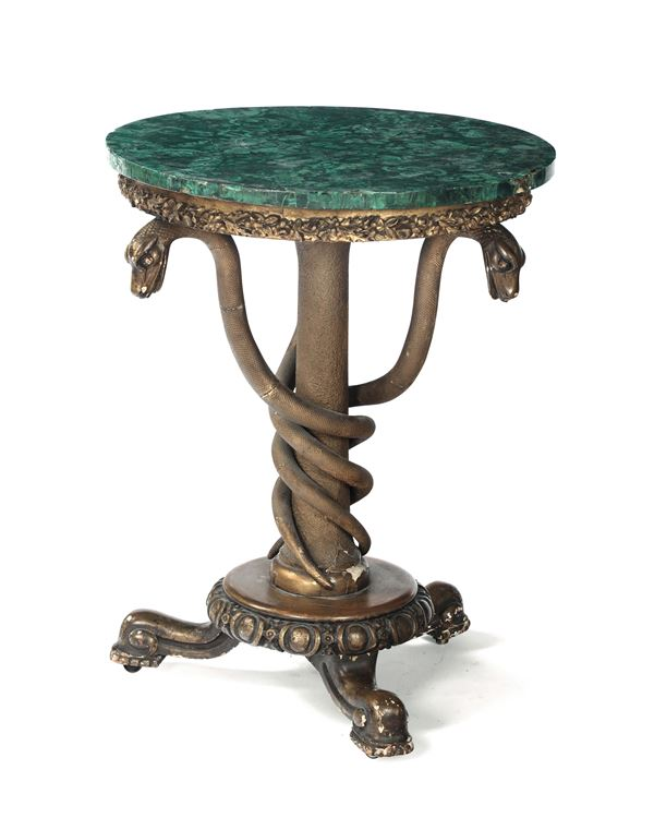 A table in carved and gilded wood with a round malachite top, 19th century