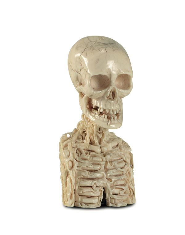 A memento mori in ivory, carved as a skeleton bust being eaten by worms. Germany (?), 18th-19th centu [..]
