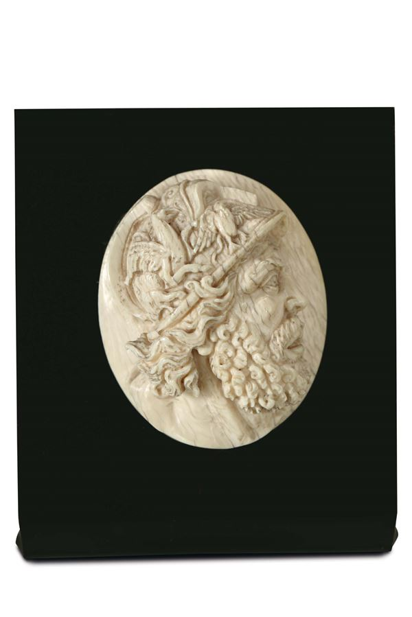 A profile of the god Ares (Mars) in carved ivory. Southern Germany 18th century