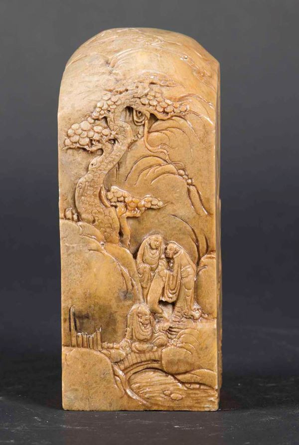 A soapstone seal with figures within a landscape, China, Qing Dinasty, 19th century