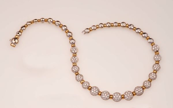 Diamond and gold necklace. Designed as a graduated series of spheres pavé-set with brilliant-cut diamonds