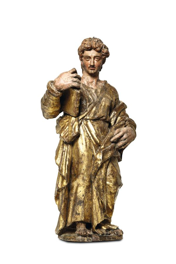 An Evangelist Saint in polychrome and gilded wood. Sculptor close to Alonso Berruguete, Spain, 16th century