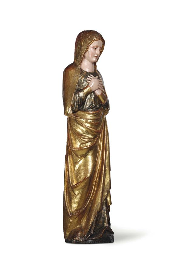 A pair of calvary figures depicting the weeping Virgin and Saint John the Evangelist in polychrome and gilded wood. Spanish art from the 15th century