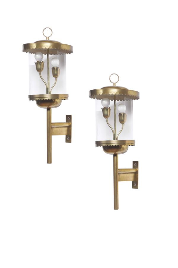 A pair of large wall lamps with a brass structure and glass diffusers. Italy, 1950 ca.