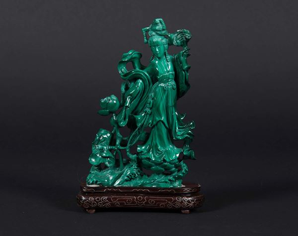 A Guanyin figure with roses in malachite, China, early 20th century