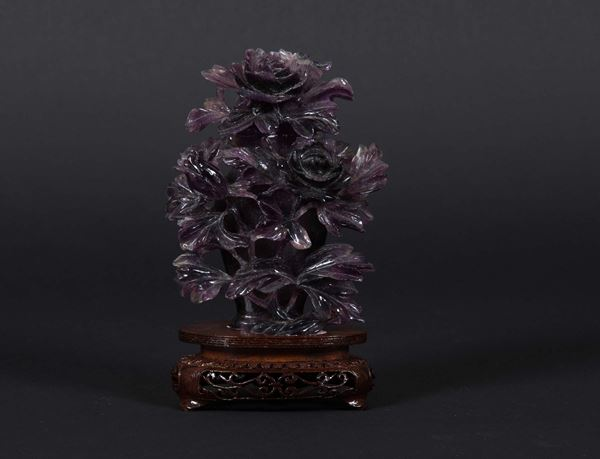 An amethyst vase with embossed floral decorations, China, 20th century