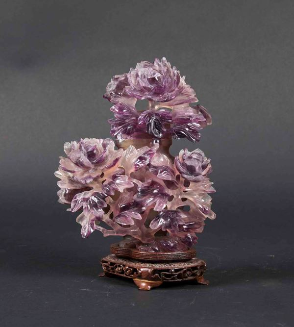 A carved amethyst vase and lid with blossoming peonies, China, Qing Dynasty, early 20th century