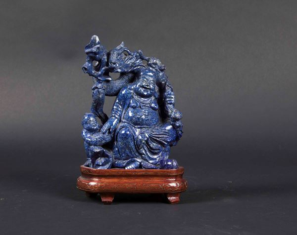 A carved lapis lazuli group depicting a sitting Budai with child, China, Republican era, 20th century