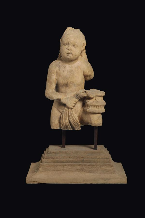 A cherub torso in stone. Tuscan Renaissance lapidary active in the second half of the 15th century