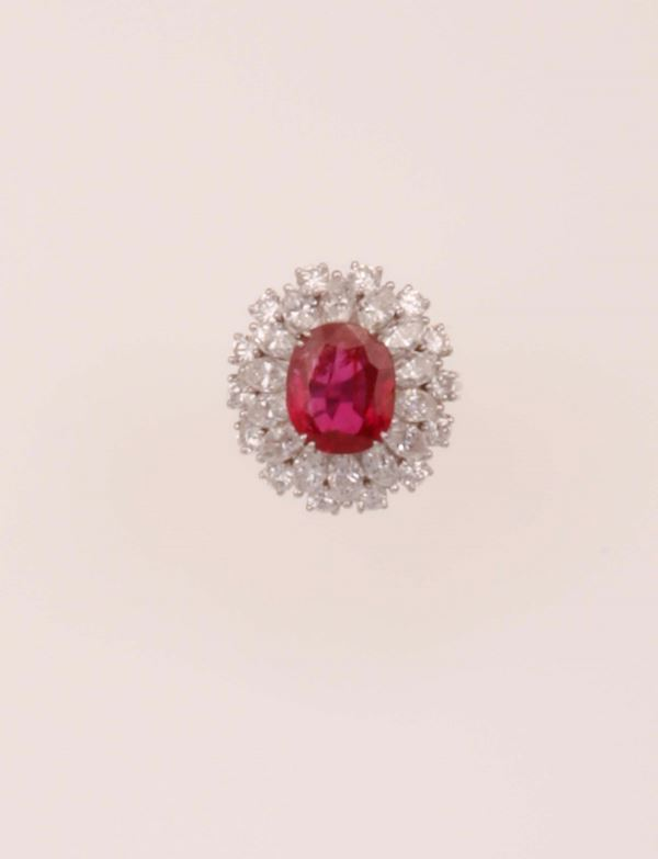 Ruby and diamond ring. Ruby weighing 4.38 carats and is of Burmese origin, no indications of heatin