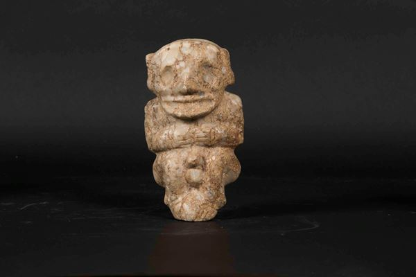 A hermaphrodite figure in jade with incorporations, China, likely from the Neolithic period