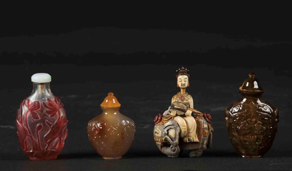 A lot made up by four snuff bottles in various materials: agate, tiger's eye, ivory and glass, China, early 20th century