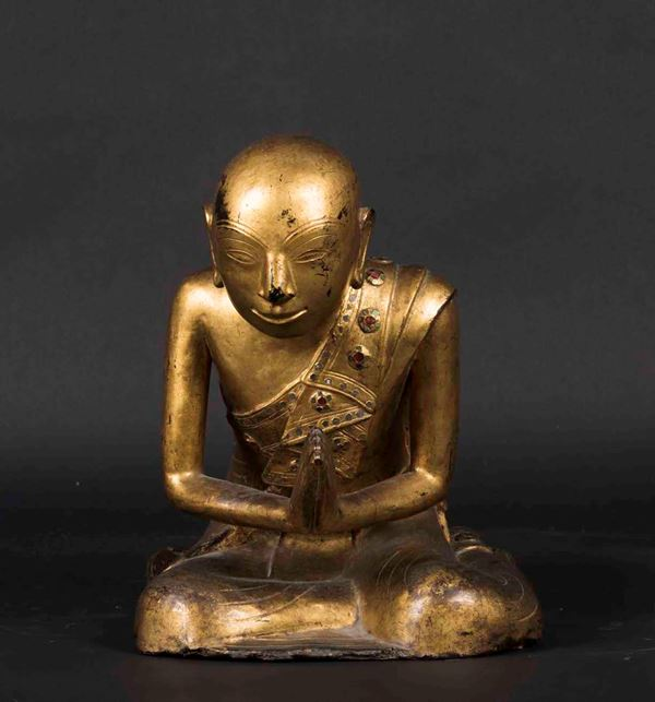 A figure of a praying monk in carved and gilt wood, Thailand, 20th century